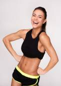 Cheerfully smiling mixed race sporty woman — Stock Photo