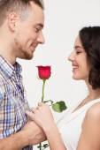 Man giving a rose to his beloved — Stock Photo