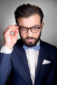 Handsome man with beard and glasses looking at camera — Photo
