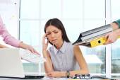Tired overworked young businesswoman with folders — Stock Photo