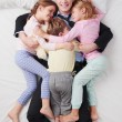 Top view of smiling businessman and his three children — Stock Photo #69417459