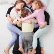 Top view of tired businessman and his three children — Stock Photo #69418721