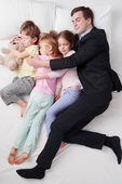 Top view of chidren sleeping with father — Stock Photo