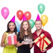 Happy people with birthday hats and colourful presents — Stock Photo #69641791