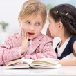 Two little girls whispering secrets — Stock Photo #71644791