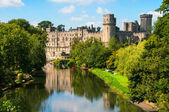 Warwick castle in UK with river — Stock Photo