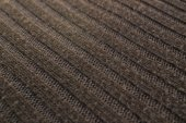 Brown woolen knitted fabric angle — Stock Photo
