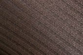 Brown woolen knitted fabric — Stock Photo