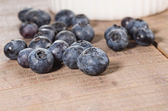 Fresh blueberries on a wooden table — Stock Photo