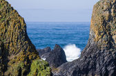 Towering rock formations with surf — Stock Photo