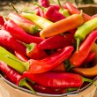 Wooden basket full of hot peppers — Stock Photo #57230097
