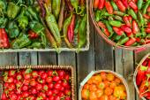 Assorted peppers in different baskets — Stock Photo