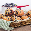 Wicker basket of berry muffins — Stock Photo #58023193