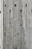 Vertical weathered boards with nail holes for use as texture — Stock Photo