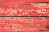 Red painted wooden siding boards — Stock Photo