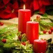 Christmas centerpiece with red poinsettias — Stock Photo #59287555