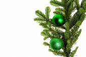 Noble fir bough with green ornaments — Stock Photo