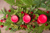 Three red candles in a Christmas arrangement overhead view — Stock Photo