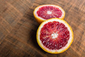 Blood orange halves on table — Stockfoto
