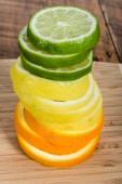 Stack of lemon, lime  orange — Stock Photo