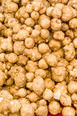 Jerusalem artichoke tubers at the market — Stock Photo