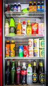Hard drink and soft drink in refrigerator — Stock Photo