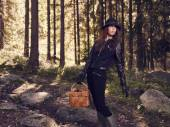 Woman and mushroom basket — Stock Photo