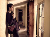 Fashionable girl and retro corridor — Stock Photo