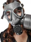 Young adult woman and gas mask — Stock fotografie