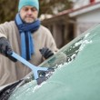 Male and ice scraper — Stock Photo #60936507