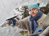 Male and ice scraper — Stock Photo