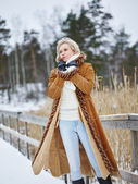 Fashionable woman and winter clothes - rural scene — Stock Photo