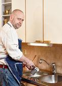 Man washing a dishes — Stock Photo