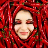 Woman and red chili pepper — Stock Photo