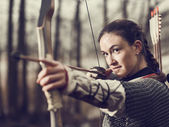 Medieval archery, woman shoot — Stock Photo