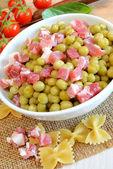 Peas and bacon — Stock Photo