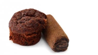 Chocolate muffin rotating on white background — Stock Video