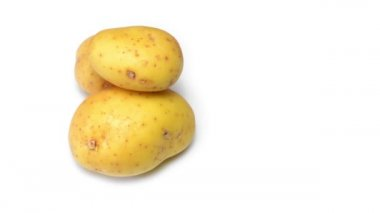 Potatoes rotating on white background — Stock Video