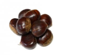 Chestnuts rotating on withe background — Stock Video