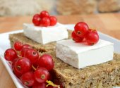 Wheat bread cheese and red fruit — Stock Photo