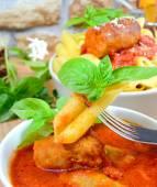 Rigatoni italian pasta with tomato sauce — Stock Photo