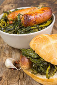 Broccoli and sausages — Stock Photo