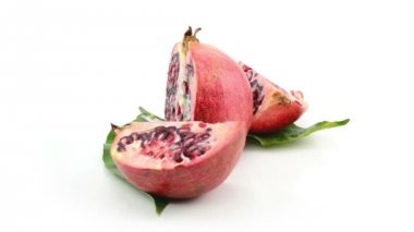 Pomegranate on white background — Stock Video