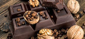 Chocolate and walnuts — Stock Photo
