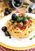 Linguine pasta olive and capers — Stock Photo