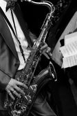 The man playing the saxophone — Stock Photo