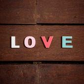 Word love on the wooden floor — Stock Photo