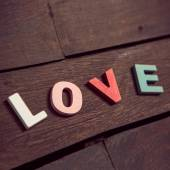 Word love on the wooden floor — Stock Photo
