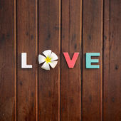 Word love on the wooden table — Stock Photo