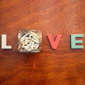 Word love on a wooden board — Stock Photo